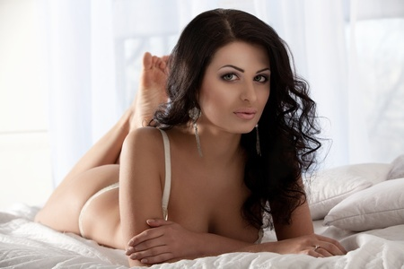 sexy-brunette-hopping-into-bed