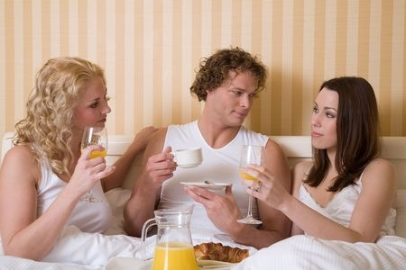 young-man-with-two-hot-women